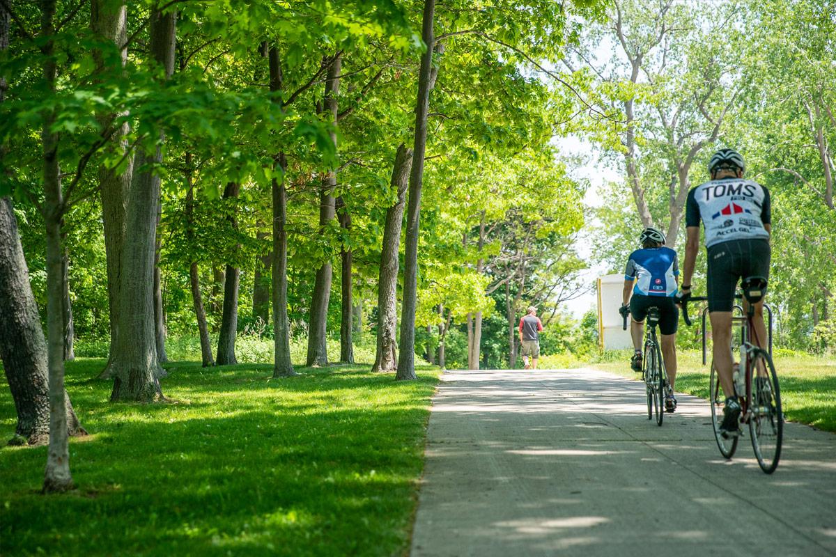 cicylists ride on trail
