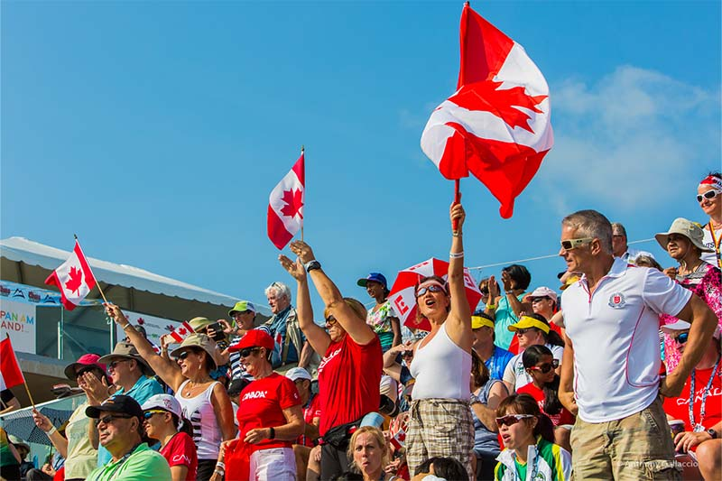 crowd of spectators waves Canadian Flag at 2015 Pan Am Games